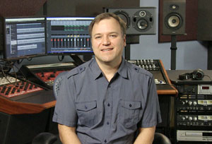 Jim Pavett in front of audio recording equipment